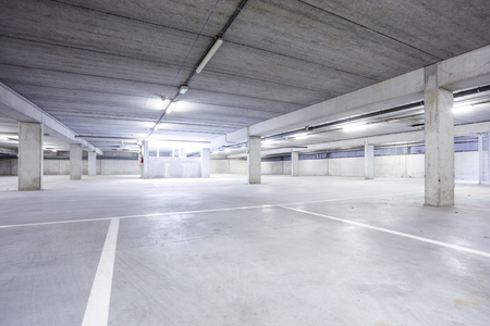 carpark: Underground park of a mall with columns and ventilation ducts Stock Photo