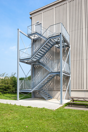 an tall building there is an emergency staircase Stock Photo