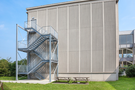 emergency stair: an tall building there is an emergency staircase Stock Photo