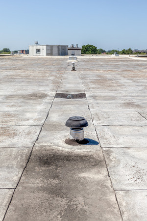 inox: inox Chimney on the flat roof in the city