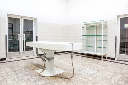 coroner: Autopsy antique tables in the morgue in clinic