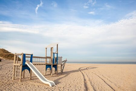 the longest beach at the sea is this beautiful wooden play Stock Photo