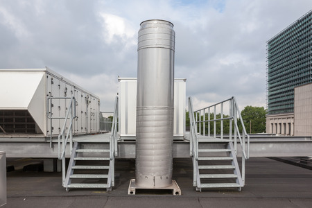 metal staircase with air ducts on the roof Stock Photo - 67657472