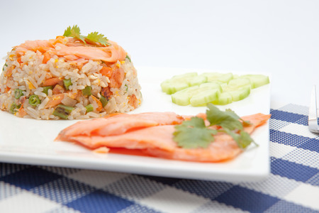 scampi: On an plate there is Thai food whit salmon and scampi