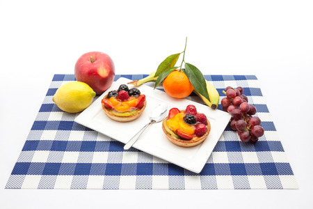 fruit tart: on an plate of delicious fruit tart Stock Photo