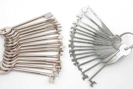 latchkey: several lockpicking to open a lock on a door Stock Photo