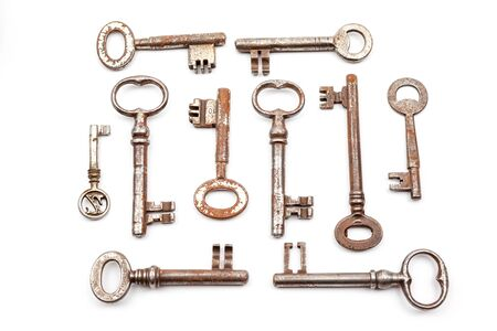 privilege: rusty antique house keys with different motives