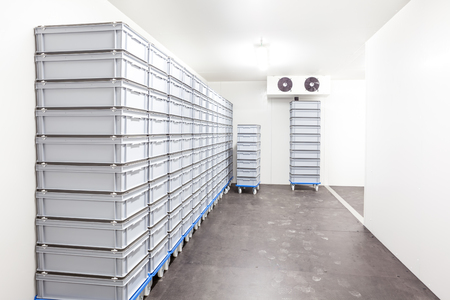 an industrial room refrigerator with two fans