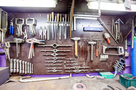 reversed: in a workshop of metal, this old workbench