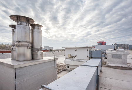 roofing system: inox Chimney on the flat roof in the city