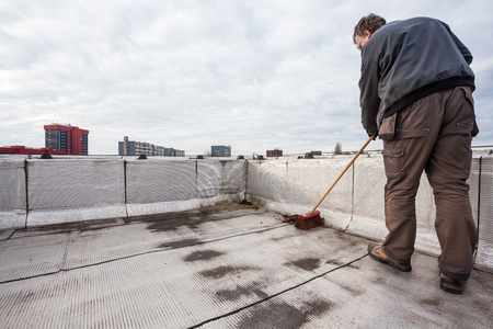 waterproofing material: an flat roof with roofing and fencing Stock Photo