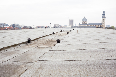 waterproofing material: an flat roof with roofing and Safety line Stock Photo