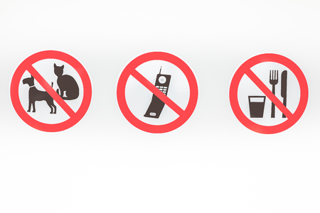 On this wall there are three prohibitions of no pets, no cellphone and no food or drink Stock Photo