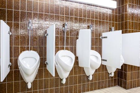bathroom design: urinals in an old building for men only Stock Photo