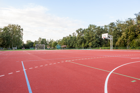 Outside the park there is a basketball court