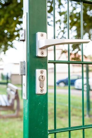 door handle: an security lock with cylinder and an handle in an iron fences
