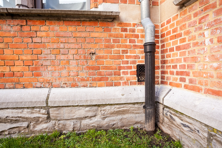 an rain drain pipe on an wall Stock Photo