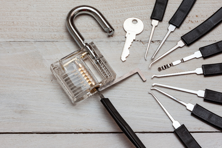 several lockpicking to open a lock on a door 版權商用圖片