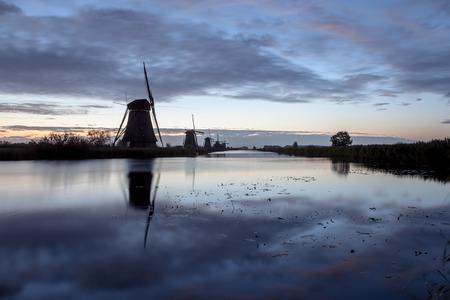 fog near the windmills in Kinderdijk in Holland