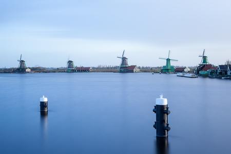 Zaanse schans are windmills along a river