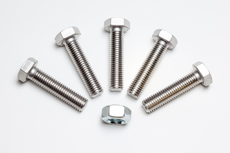 these five bolts and an nut are on a white background
