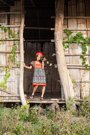 Thai girl play around whit traditional Thai costume