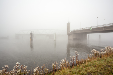 this bridge is under a thick fog on an morning