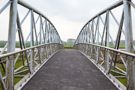 in the outskirts of the city this bicycle bridge runs over a busy motorway