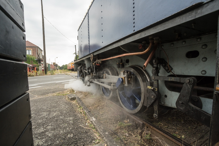 in an old station there is a steam trien waiting for his passengers Stock Photo