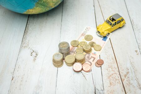 Money, globe and car on wooden table Stock fotó
