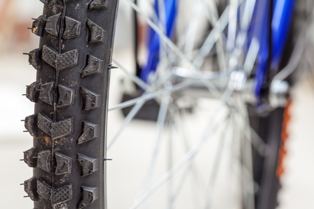 close up of a tire of a childrens bicycle wheel