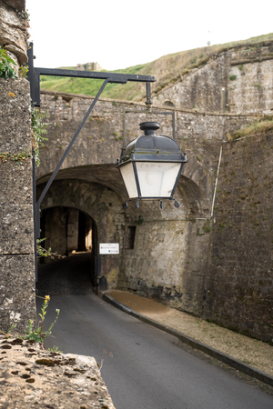 In France you find this antique street lamps hanging longest wall Stock Photo