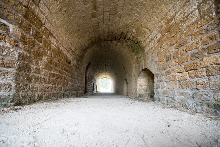 under an old castle there is a pedestrian curved tunnel