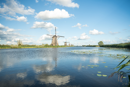 on the water there are several windmills in Kinderdijk in Holland Stockfoto