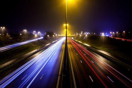 during the evening on a busy motorway with slow shutter speed you get light stripes