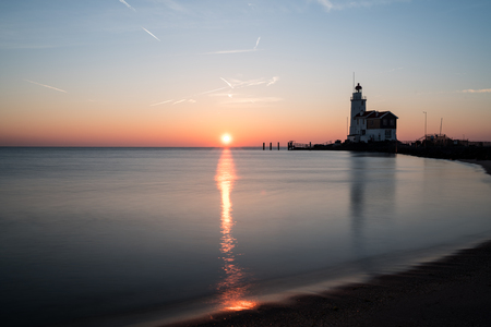this beautiful lighthouse whit sunriseon a beautiful day at sea in Marken
