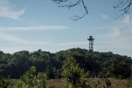 fire lookout tower in the calmthout heathland nature reserve next to the busy port of Antwerp