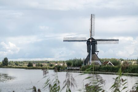 on the water there are several windmills in Kinderdijk in Holland 스톡 콘텐츠