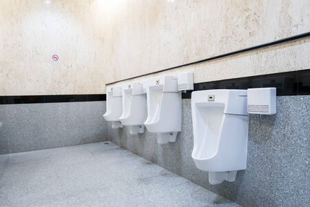 urinals in an old building for men only Stock fotó
