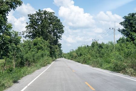 Road in the mountain whit trees in Thailand whit a cloudy day