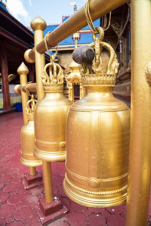 these beautiful bronze bells hang in the temple in Thailand, is part of their religion