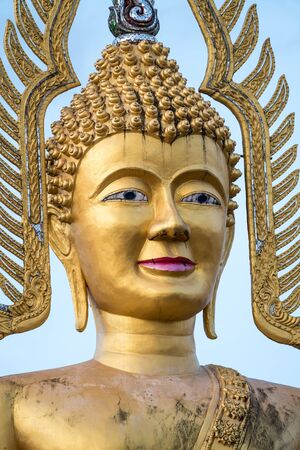 Next to the Thai temple there is an  big buddha whit blue sky