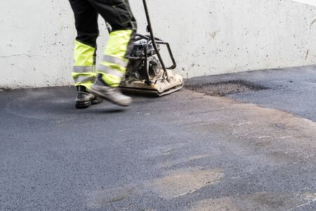 an top layer of asphalt is now laid on a surface