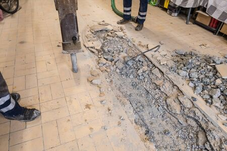 Tile floor breakout for renewing the underlying drain pipe Stock Photo