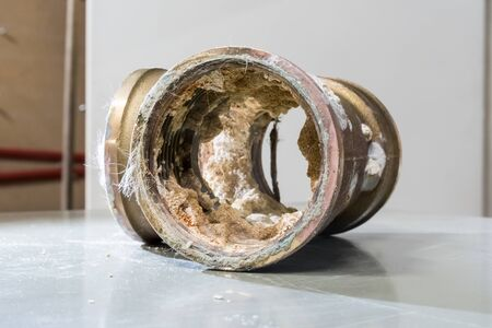 A calcified and knocked out by lead in the Yellow copper tee for water supply