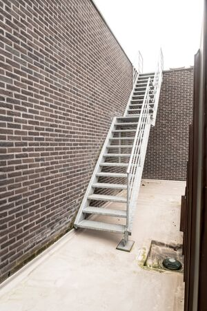 on an roof of an building there is an emergency staircase Stockfoto