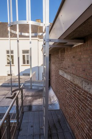 on an roof of an building there is an emergency staircase