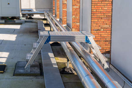 an aluminum switch in the technical area on the roof, there are boosters for the water pipes of the building