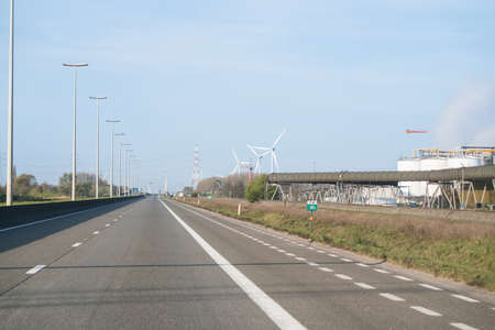 on the highway you see in the distance a wind farm