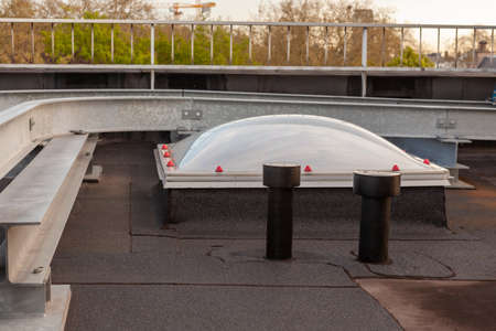 Plastic dome on a flat roof on a large building in the heart of the city
